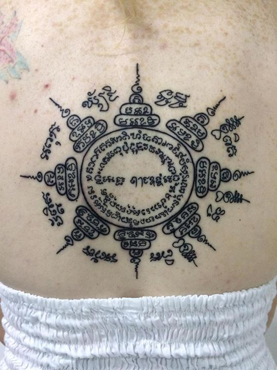 Sak Yant style tattoo on back by Noenoe Shadow