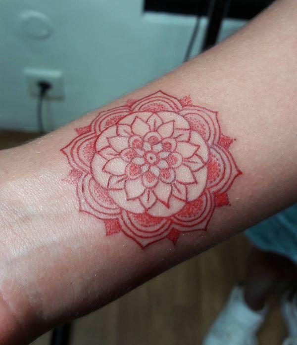 Red mandala tattoo by Indra Nice Art Tattoo
