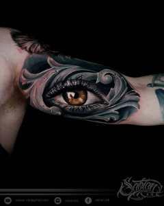 Brown eye tattoo by Sabian Ink artist Dena Rio