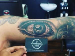 Eyeball with clock Roman numerals by Kuta Inked Tattoo