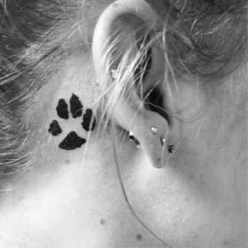 Dog feet tattoo