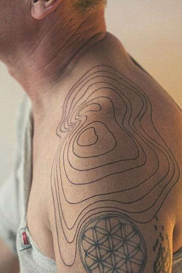 Relief Lines Shoulder Tattoo