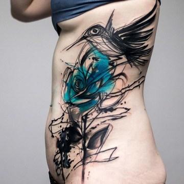 Sketchy bird & rose side tattoo