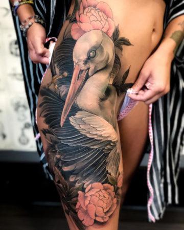 Stork & Peonies hip tattoo