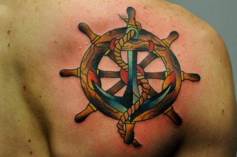 Amazing anchor and wheel tattoo