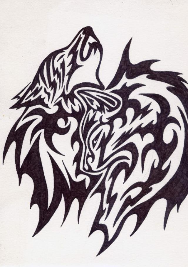 Awesome tribal wolf tattoo sample