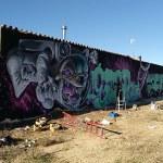 mural graffiti tres pasos palencia perro cósmico