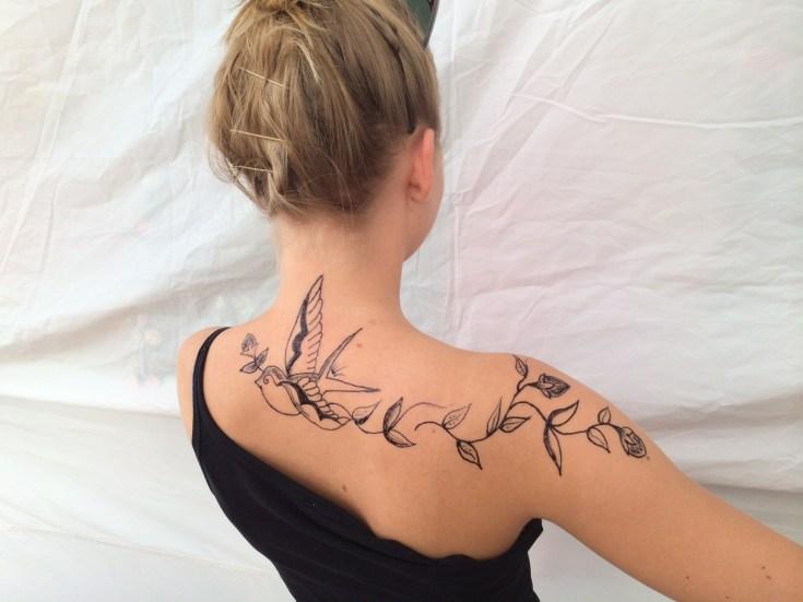 jagua back tattoo