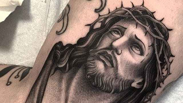 black grey jesus tattoo