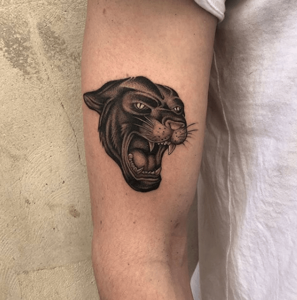 black panther forearm tattoo