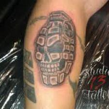 Signification de tatouage de grenade 42