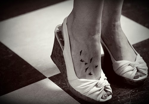 15 Cute And Lovely Bird Tattoo On Foot Ideas And Designs