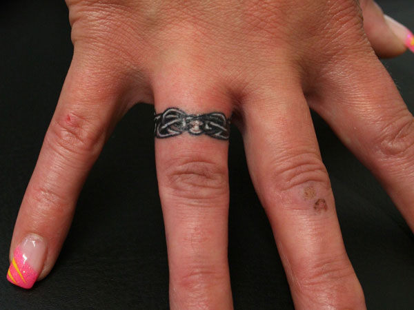25 Marvelous Ring Finger Tattoos Slodive Ideas And Designs