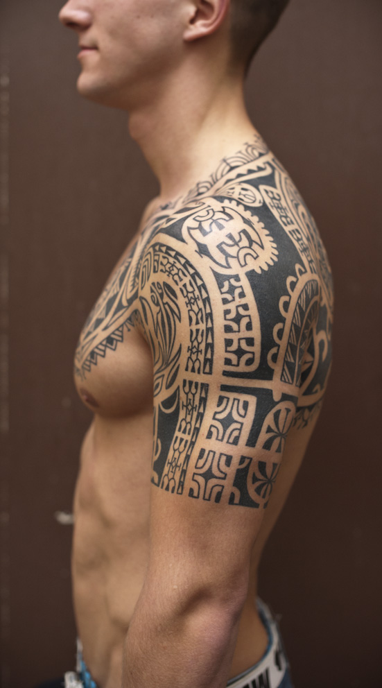 Grey Ink Man Chest And Half Sleeve Tattoo For Men Ideas And Designs