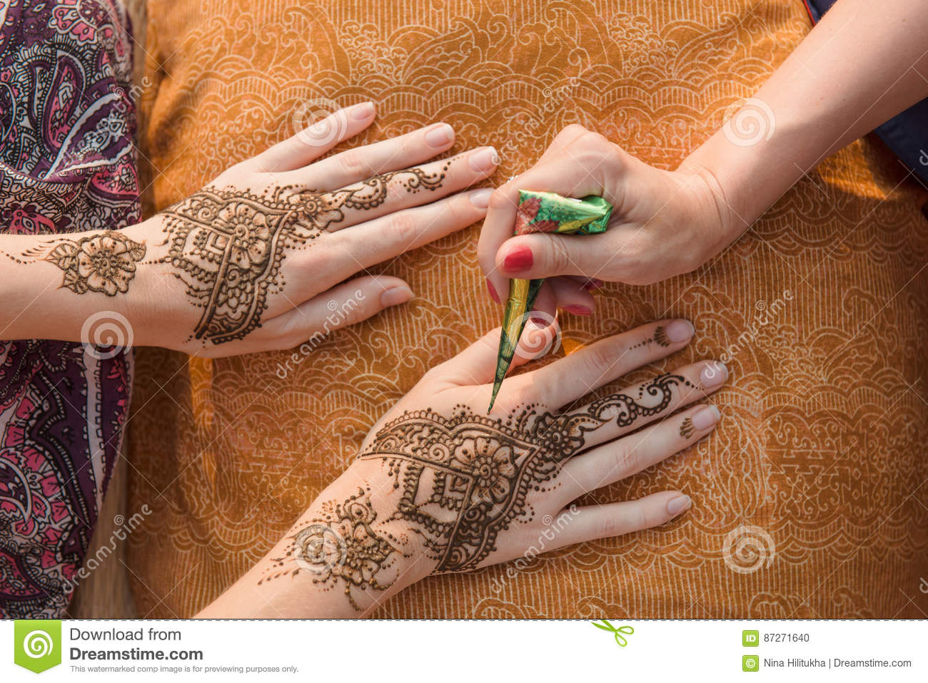 Applying Henna Tattoo On Women Hands Stock Photo Image Ideas And Designs