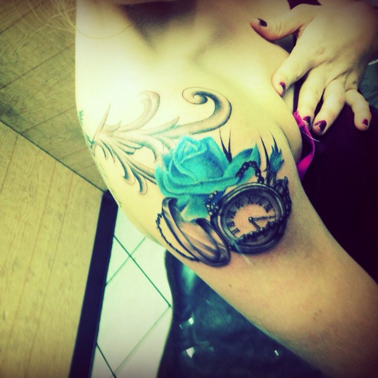 Blue Rose And Pocket Watch Tattoo Symbolizing The Ideas And Designs