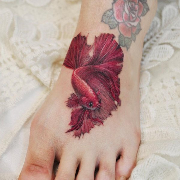 red fish tattoos for girls