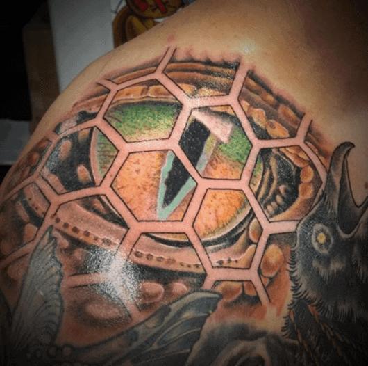 geometric snake eye tattoo design