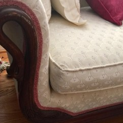 Wood accent on Formal Couch