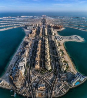 The Palm Jebel Ali, Dubai United Arab Emirates - Air travel, Artificial island, Azure, Blue, Building, Cloud, Coastal and oceanic landforms, Infrastructure, Sky, Urban design, Water, Water resources