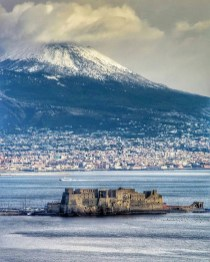 Naples, Italy - Building, Cloud, Coastal and oceanic landforms, Highland, Ice cap, Lake, Mountain, Natural landscape, Sky, Snow, Water, Water resources