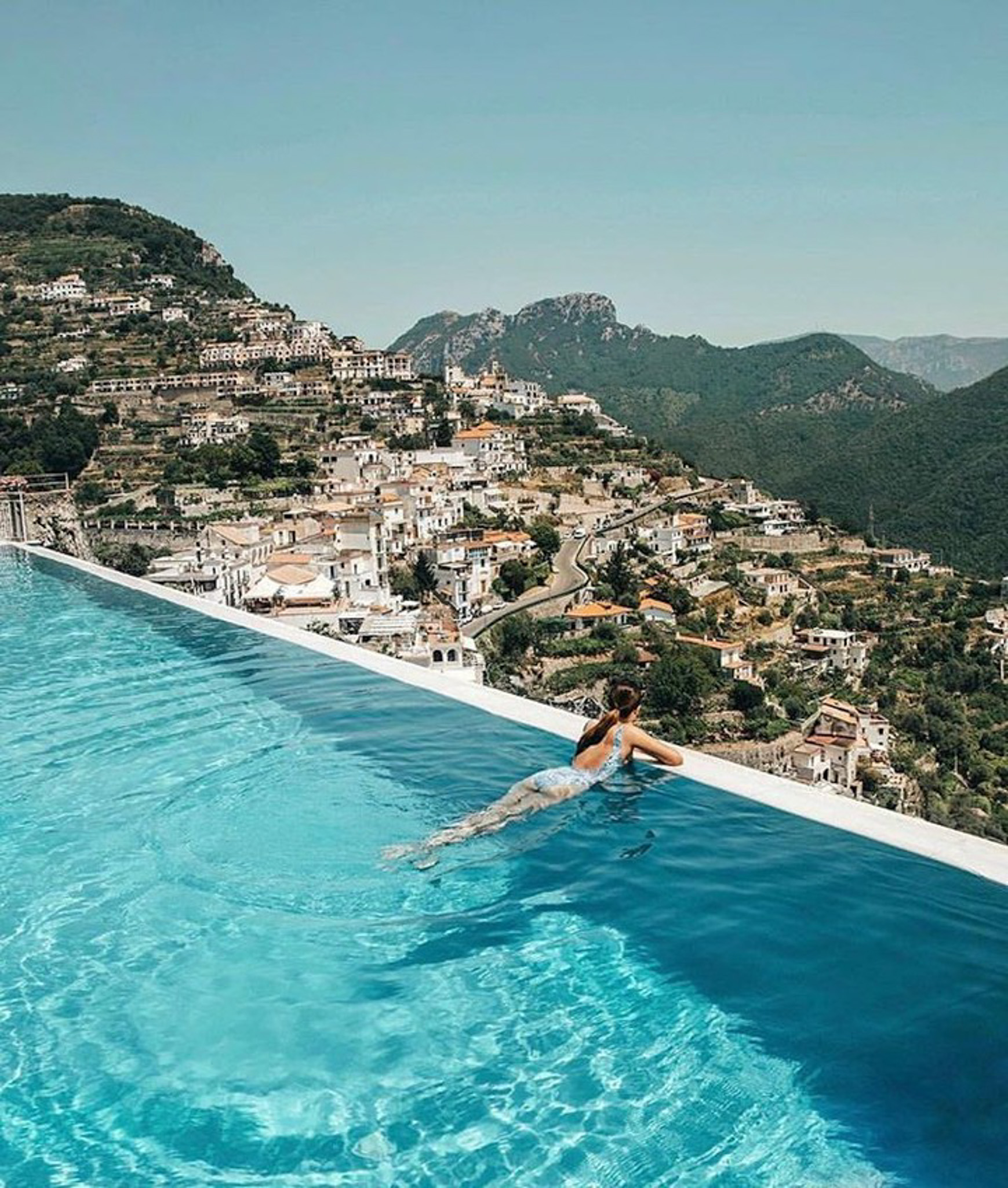 Ravello,   Italy - Azure, Building, Coastal and oceanic landforms, Leisure, Mountain, Person, Sky, Swimming pool, Travel, Water