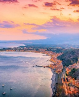 Taormina, Italy - Afterglow, Atmosphere, Bank, Body of water, Cloud, Coastal and oceanic landforms, Dusk, Horizon, Lake, Landscape, Natural landscape, Red sky at morning, Sky, Sunrise, Sunset, Water, Water resources