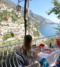 Positano, Campania Salerno Italy - Azure, Blue, Building, Chair, Dress, Food, Leaf, Leisure, Morning, Mountain, Nature, Outdoor furniture, Person, Property, Sky, Table, Tableware, Travel, Tree, Water