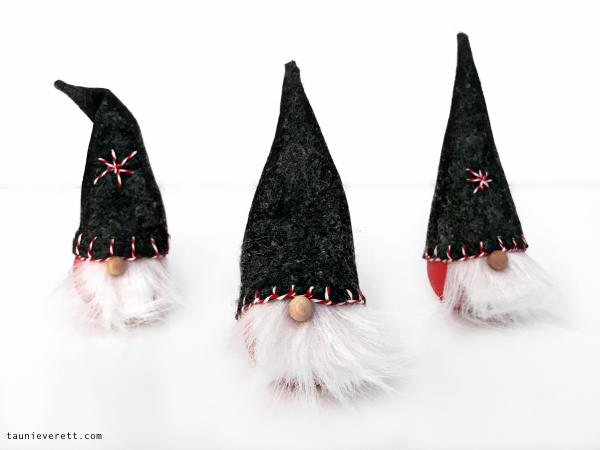 DIY Christmas Gnome. These easy, inexpensive gnomes can be made in less than 30 minutes and look great on a tree or a shelf! #christmas #gnome #christmasgnome