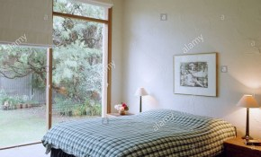 Check Duvet On Bed In Modern Bedroom With White Blinds And View Of within Modern Bedroom Blinds