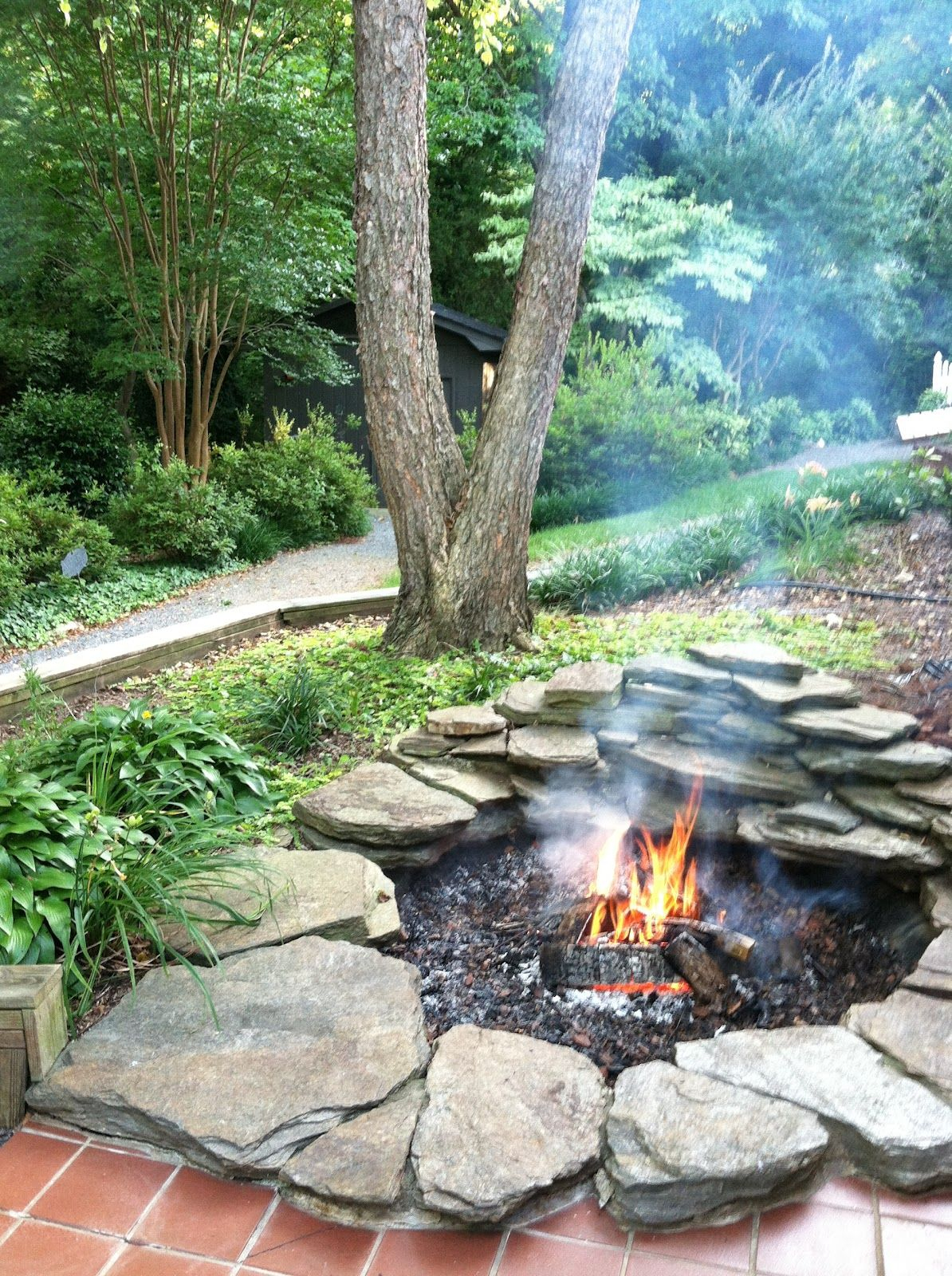 10 Fire Pit Ideas Bhgs Time Savers For Busy Families Backyard for Backyard Rock Fire Pit Ideas