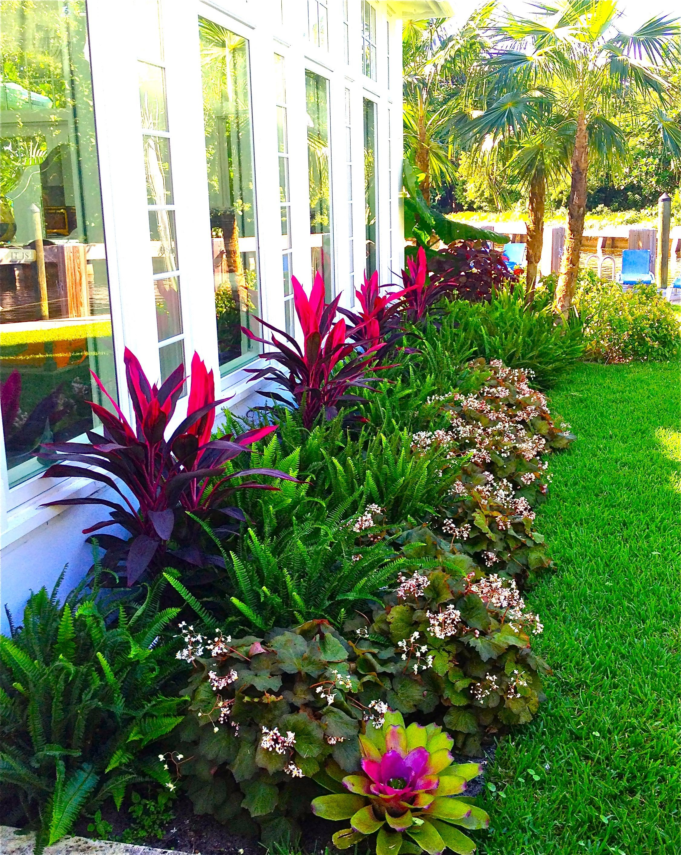 Stunning Way To Add Tropical Colors To Your Outdoor Landscaping for Tropical Backyard Design Ideas