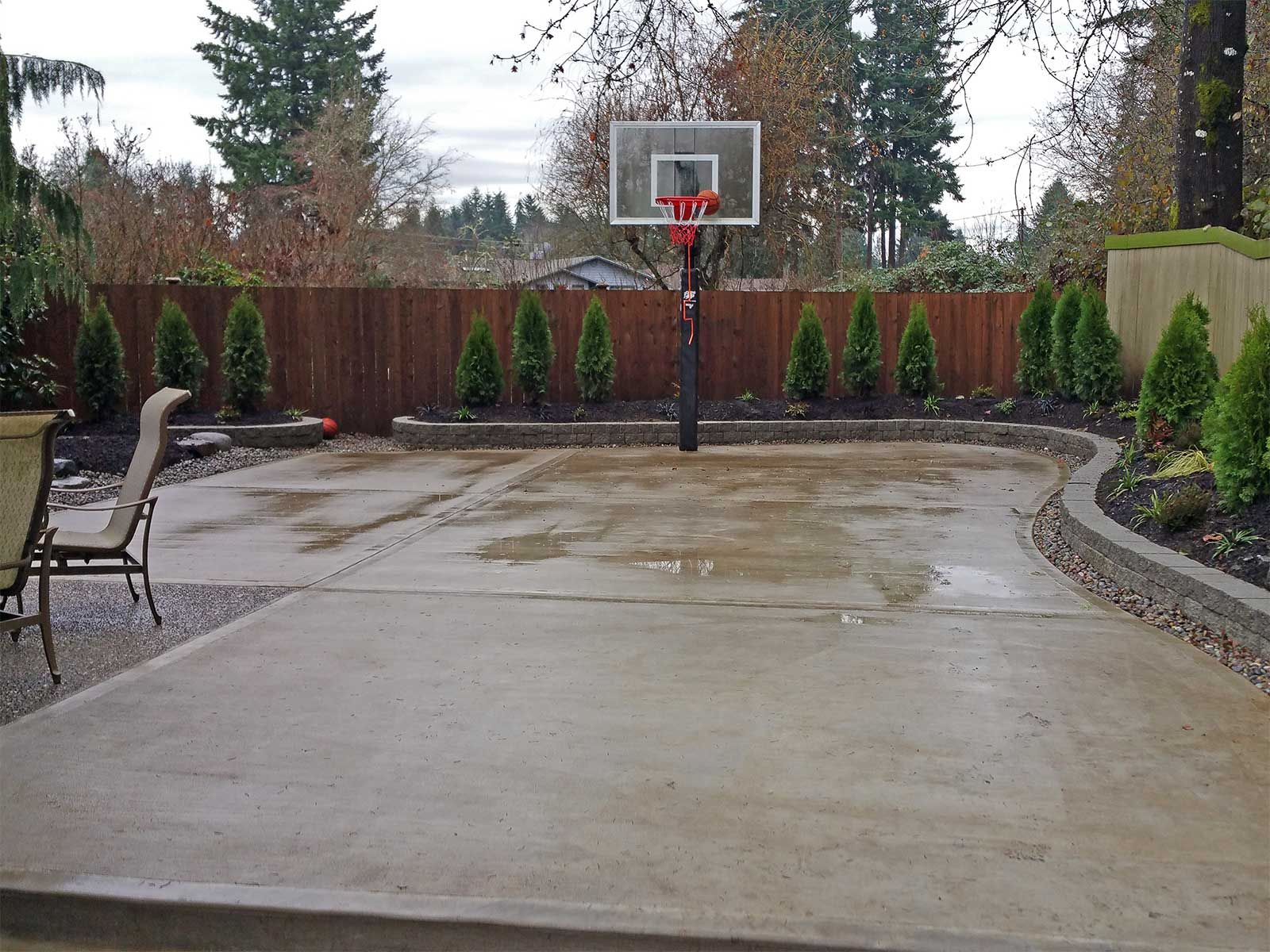 The Concrete Slab Basketball Court Is Great Exercise For The Whole throughout Cement Ideas For Backyard