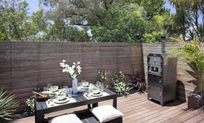 Hardwood Deck Built Over Sloping Land Provides Outdoor Entertaining inside 13 Clever Concepts of How to Makeover Sloped Backyard Deck Ideas