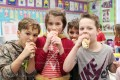 Grade 3 students Jake Hauss, Ella King and Hayden McCann enjoy their pitas for Pita Day at Tavistock Public School last Friday, February 5th.