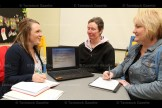 Oxford Small Business Support Centre Young Entrepreneur Program Coordinator Lindsay Wilson (left) speaks with Evelyn Vos (centre) and Jan Ramseyer at the Tavistock Library on Wednesday, March 23, 2016.