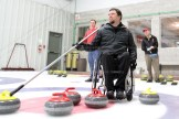 Mike Munro lines up a shot as skip for his team at the Tavistock Curling Club.