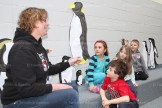 TPS Kindergarten teacher Jackie Verhoeven discusses penguins with some of her students, from the left, Lily Hauss, Peyton Christie, Ruby Locke, and Ben Church. The childrens' lifesize penguins are on display on the wall in the school amphitheatre.