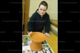 Jacob Bergsma, 11, of Tavistock, turns his bird bath over ready for decorting at the next meeting.
