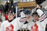 Stratford Cullitons players Tristan Hohl (left) and Deven Kropf hoist the Cherrey Cup as winners of the Mid-Western Junior Hockey League. The Cullitons are tied 1-1 with the London Nationals for the Provincial Championship Sutherland Cup.