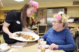 Residents at peopleCare, Tavistock, enjoyed a birthday tea in the nursing home's dining room on the occasion of Queen Elizabeth II's 90th birthday last Thursday, April 21st. Sporting their fascinators, above, Marjorie Fox is offered some tasty treats by staff member Lindsay Marsh.