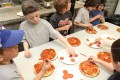 Making pizzas for the Grade 1 class of Michelle Nahrgang last Friday morning are from the left: Cohen Smith, Sam Harnack and Jagger Stigter.