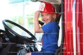 Noah Zehr enjoys his time at th wheel of the fire truck.