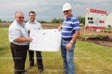From the left, Brian Wilhelm, Peter Lass and John Day look over plans for The Orchards subdivision underway for the east end of Tavistock.