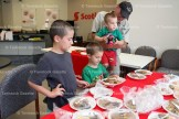 Murray Kennel treats his grandsons, Zachary, 8, Dominic, 4, and Bailey, 2, to some goodies at the Bake Sale held at Scotiabank on Monday, August 15th in support of the Stone Gates project.