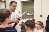 Lee Winegardner drops liquid nitrogen bubbles on children's heads at the Mad Science program held last Wednesday. August 10th at the Tavistock Library. About 25 children attended.