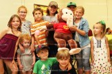 Children with Curious George at the Library birthday party are from the left, Noelle Daum, Kinley Muirhead, Peyton Muirhead, Nathan Zehr, Andrew Weitzel, Evan Britton, Chloe Britton, Addyson Keating; in front: Jeremy Caron and Jordan Caron.