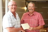 Mayor Don McKay presents a gift to Dennis O'Neil, retired East Zorra-Tavistock Director of Public Works and Development, at his retirement party last Friday at Craigowan Golf Club
