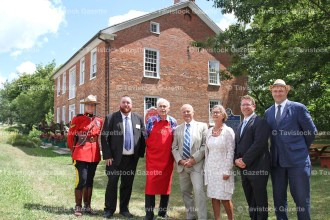 Swiss Ambassador Dr. Beat Nobs and his wife, Dr. Irene Nobs (centre) were welcomed to the Fryfogel Tavern on Saturday afternoon in a special ceremony by the Stratford Perth Heritage Foundation. From the left are RCMP Corporal Mona Eichmann, SPHF chairman Barry Nowack, board member Reg White, and at right, Perth MP John Nater and Ontario Heritage Trust Director Sean Fraser.