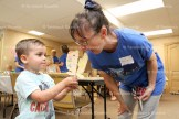 Declin McMahon, 4, tests his 'whale bite' on volunteer Laura McKay at the Tavistock Bible Chapel's Bible School last week.